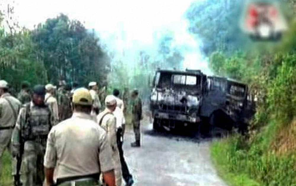 A scene after a military convoy was attacked by an unidentified insurgent outfit first with a powerful Improvised Explosive Device (IED) killing at least 18 army personnel and injuring 11 others in Manipurs Chandel district.