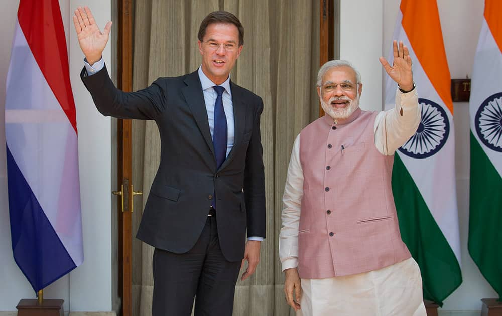 Prime Minister Narendra Modi and Netherlands Prime Minister Mark Rutte wave to the media before the start of their meeting in New Delhi. Rutte is on a three-day visit to India.