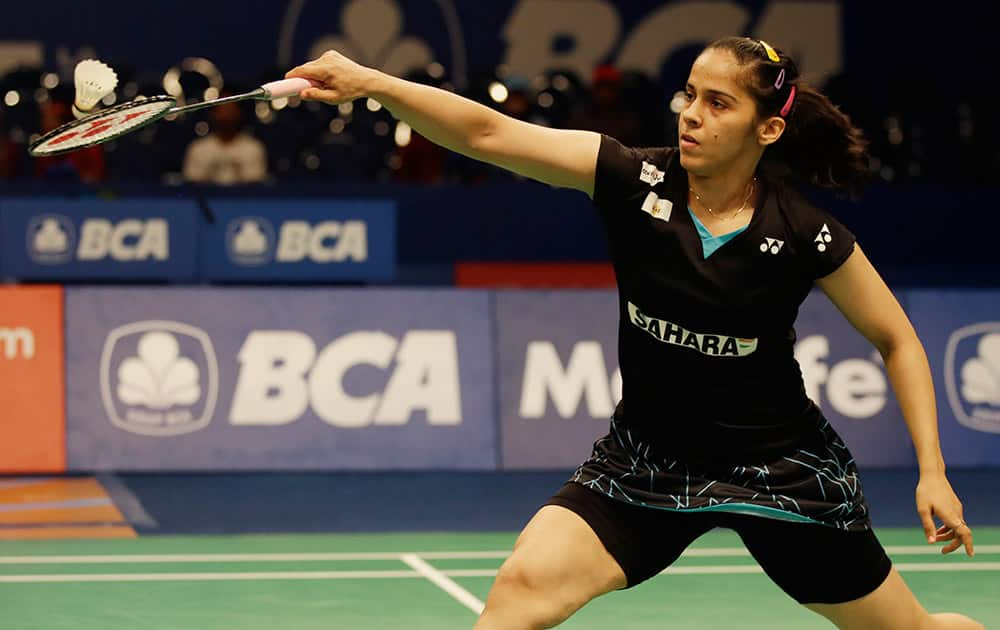 Saina Nehwal returns the shuttlecock to China's Wang Shixian during their women's singles quarterfinal match at the Indonesia Open badminton tournament at Istora Stadium in Jakarta, Indonesia.