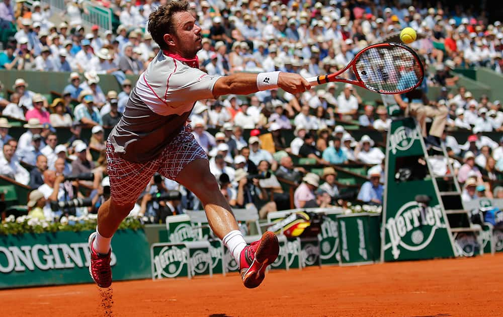 Switzerland's Stan Wawrinka returns the ball to France's Jo-Wilfried Tsonga during their semifinal match of the French Open tennis tournament at the Roland Garros stadium in Paris.