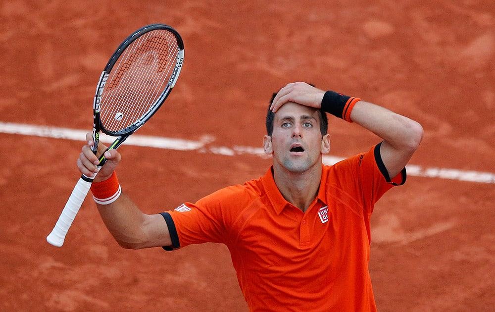 Serbia's Novak Djokovic reacts as he plays Britain's Andy Murray during their semifinal match of the French Open tennis tournament at the Roland Garros stadium in Paris, France.