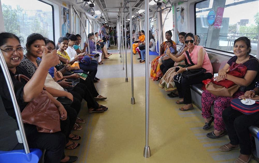 Women commuters enjoy metro ride on the 1st anniversary of Mumbai Metro.