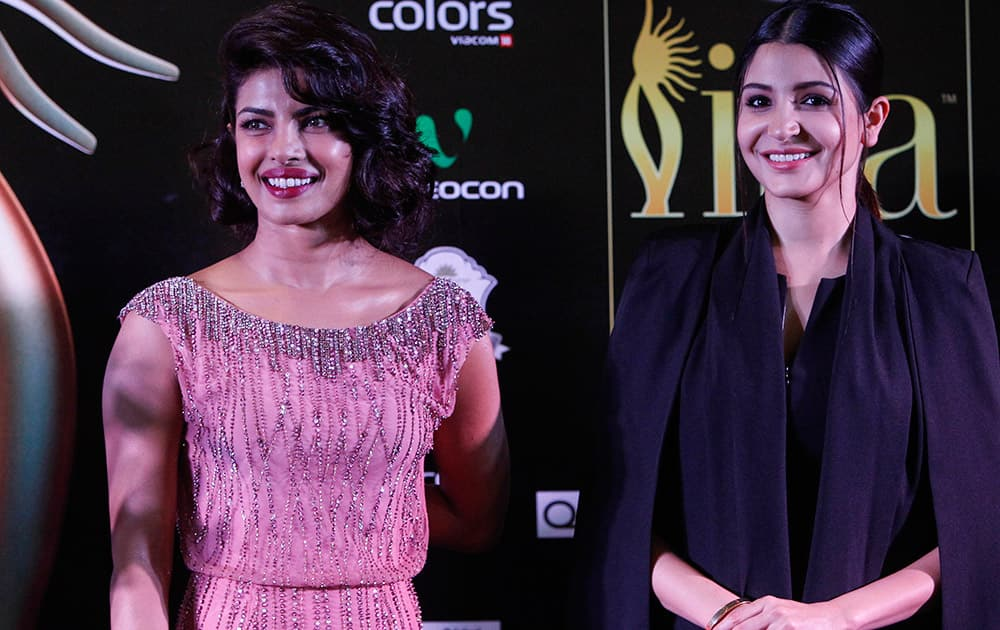 Priyanka Chopra and Anushka Sharma arrive for the IIFA Gala Screening as part of the three-day long International Indian Film Academy (IIFA) awards held in Kuala Lumpur, Malaysia.