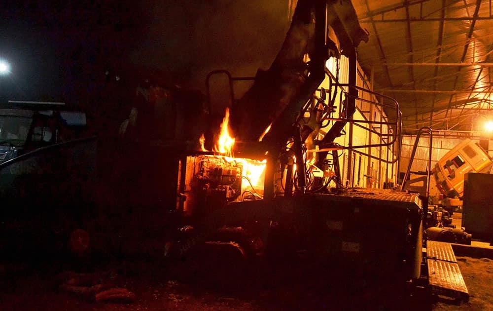 Naxals set ablaze vehicles and equipments of a road construction company at Kamtaul village in Muzaffarpur.