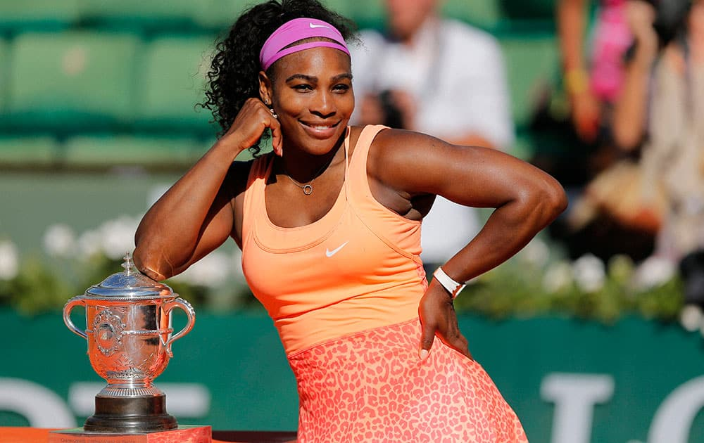 Serena Williams of the U.S. poses with the cup after defeating Lucie Safarova of the Czech Republic in their final match of the French Open tennis tournament at the Roland Garros stadium.