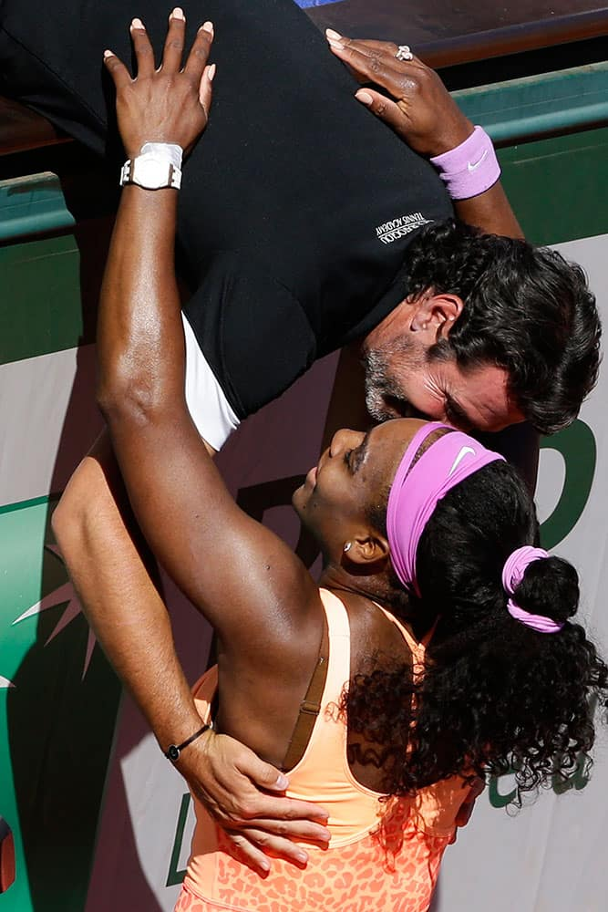 Serena Williams of the U.S. hugs her coach Patrick Mouratoglou of France after winning the final of the French Open tennis tournament against Lucie Safarova of the Czech Republic in three sets, 6-3, 6-7, 6-2, at the Roland Garros stadium.