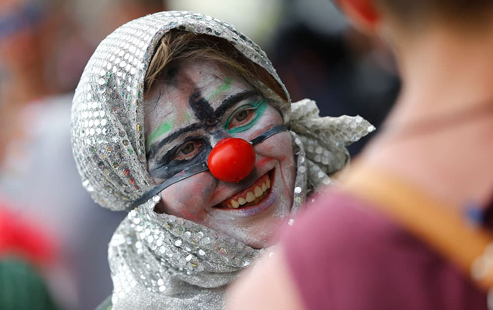 A protestor dressed as clown smiles during a protest in Garmisch-Partenkirchen, southern Germany,  against the G-7 summit in nearby Schloss Elmau hotel.