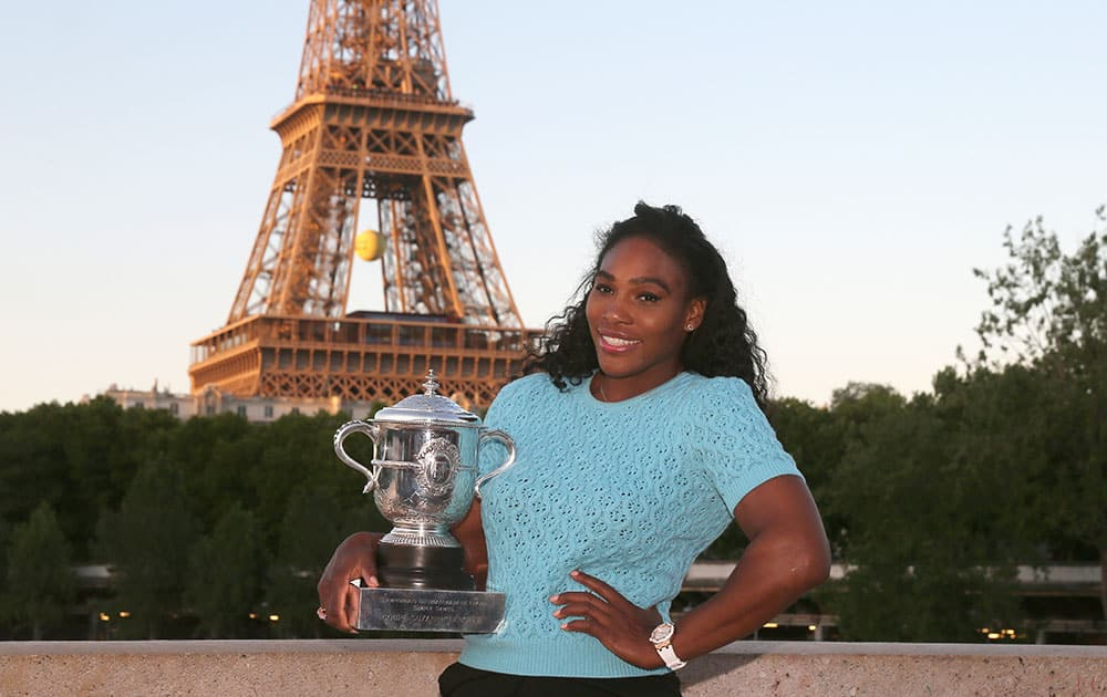 Serena Williams of the U.S. poses with her trophy after defeating Lucie Safarova of the Czech Republic in three sets, 6-3, 6-7, 6-2, in the women's final of the French Open tennis tournament, at Roland Garros stadium in Paris.