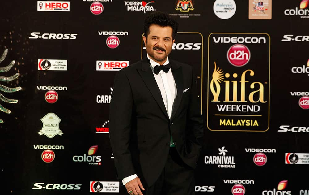 Bollywood actor Anil Kapoor poses on the green carpet at the International Indian Film Academy (IIFA) awards in Kuala Lumpur, Malaysia.