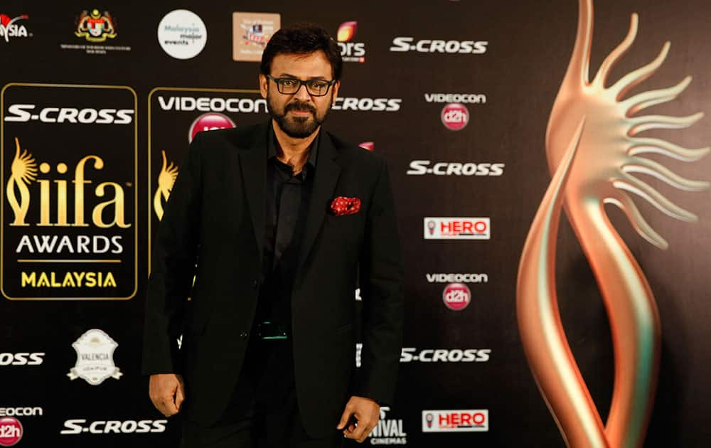 Telugu star Venkatesh poses on the green carpet as he arrives at the International Indian Film Academy (IIFA) awards in Kuala Lumpur, Malaysia.
