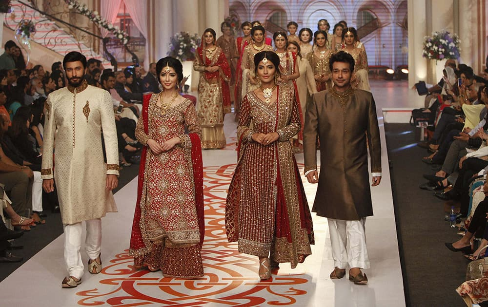 Model present creations by Pakistani designer Mifrah at Bridal Couture Week 2015.