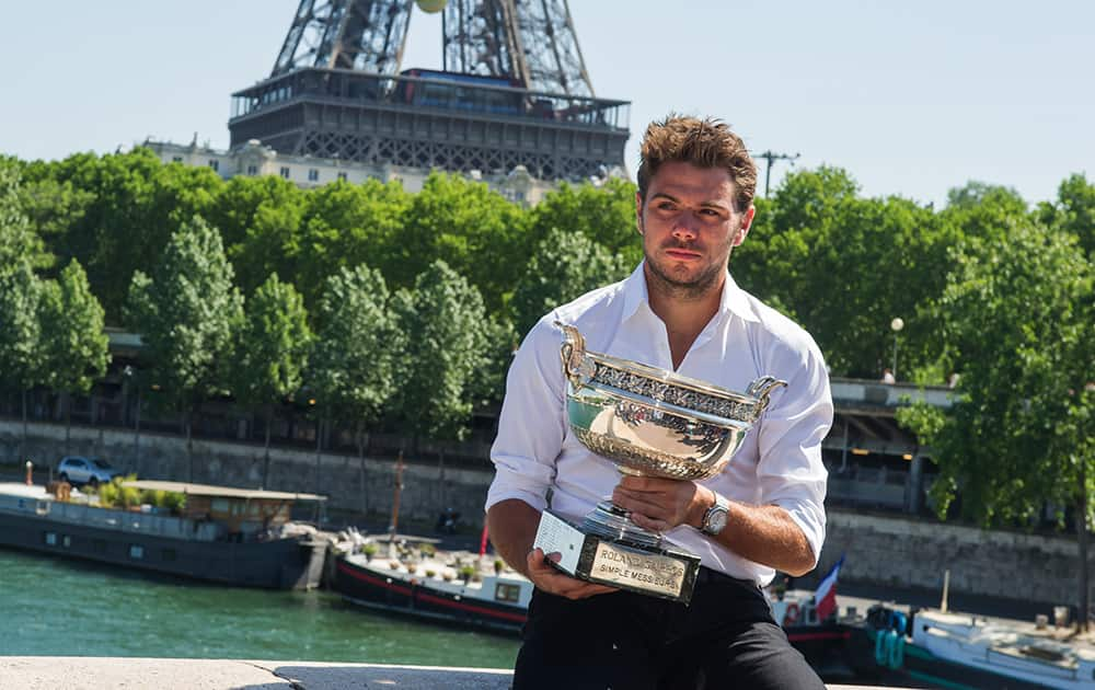 French Open Men's Singles champion Stan Wawrinka of Switzerland poses for a photo with his trophy in front of the Eiffel tower in Paris, France.