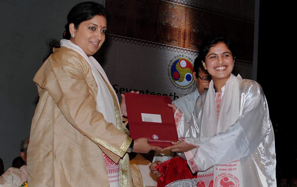 Union HRD Minister Smriti Irani presents the degree to a student during the 17th convocation of IIT - Guwahati.
