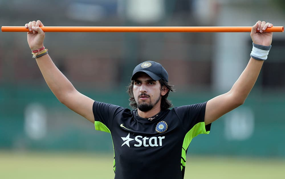 Ishant Sharma stretches during a practice session ahead of their test cricket match against Bangladesh in Dhaka, Bangladesh.