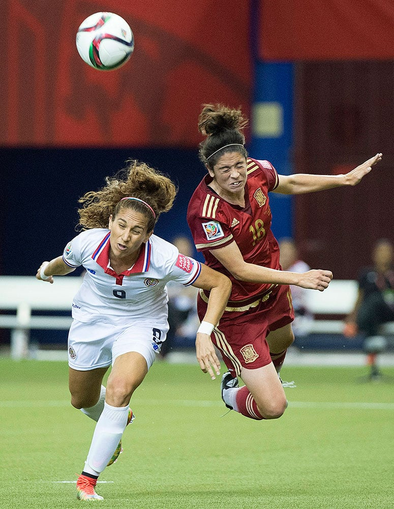 Costa Rica's Carolina Venegas, left, and Spain's Marta Torrejon (18) battle for a head ball during the first half of a FIFA Women's World Cup soccer match in Montreal, Canada.