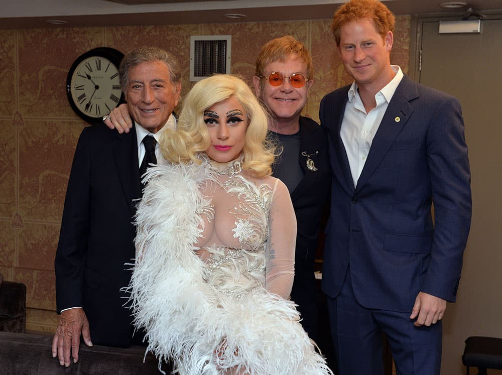 From right, Britain's Prince Harry, Elton John, Lady Gaga and Tony Bennett pose backstage for photographs after Bennett and Lady Gaga's performance as part of the Cheek to Cheek Tour at the Royal Albert Hall in London.