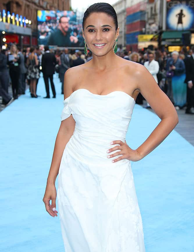 Emmanuelle Chriqui poses for photographers upon arrival at the premiere of the film Entourage in London.