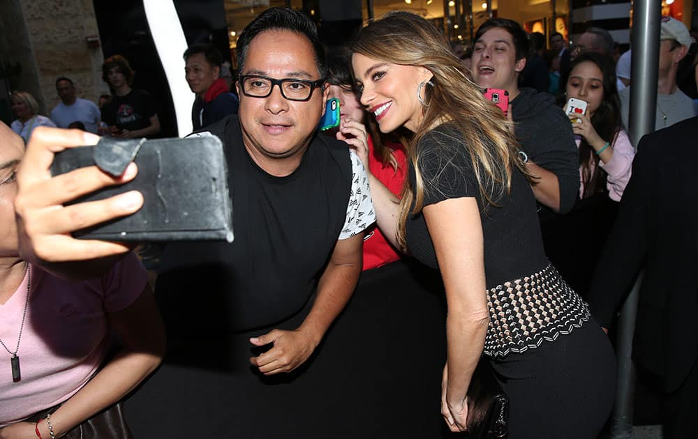 Sofia Vergara poses for a photo with a fan at the Los Angeles premiere of
