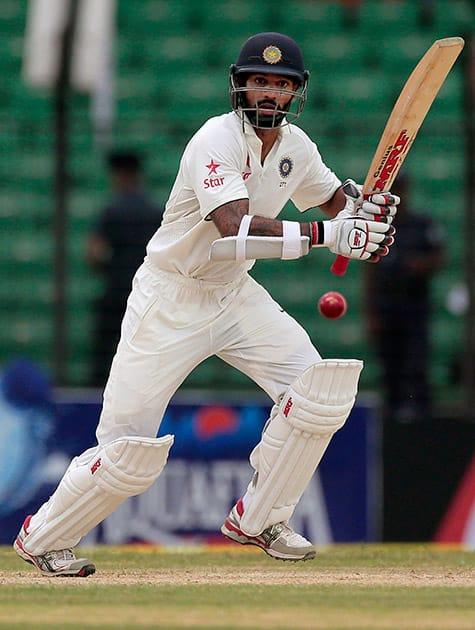 Shikhar Dhawan plays a shot during the first day of their test cricket match against Bangladesh in Fatullah, Bangladesh.
