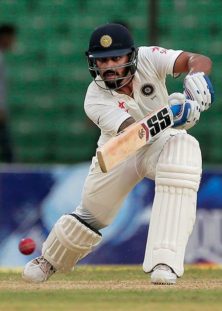 Murali Vijay plays a shot during the first day of their test cricket match against Bangladesh in Fatullah, Bangladesh.