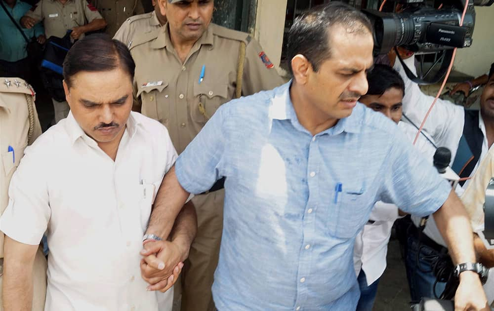 Police take former Delhi law minister Jitendra Singh Tomar to RML Awadh University in Faizabad for further investigation in fake degree case.