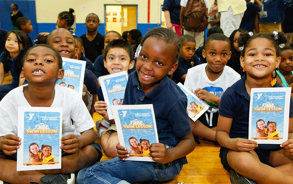 Students from Edward M. Stanton Elementary School in South Philadelphia hold certificates for free water safety lessons from their local Christian Street YMCA in Philadelphia.
