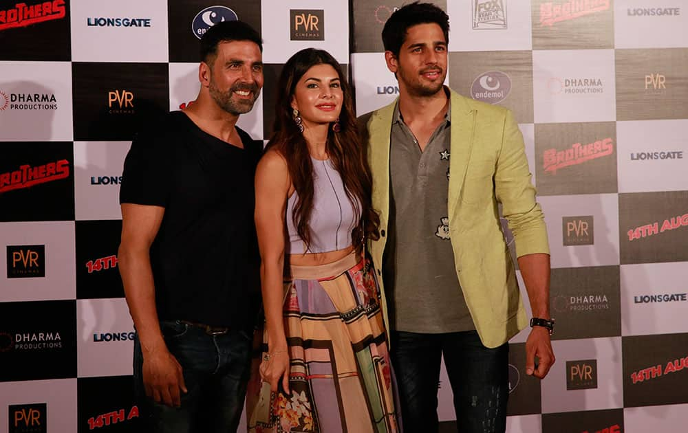 Bollywood actress, Jacqueline Fernandez poses with co actors Akshay Kumar left, and Sidharth Malhotra, right during the trailer launch of her upcoming film 'Brothers' in Mumbai, India.