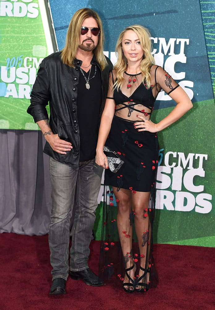 Billy Ray Cyrus, left, and Brandi Glenn Cyrus arrive at the CMT Music Awards at Bridgestone Arena, in Nashville, Tenn.