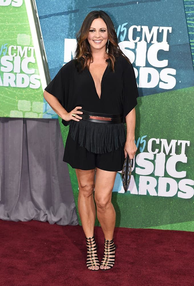 Sara Evans arrives at the CMT Music Awards at Bridgestone Arena, in Nashville, Tenn.