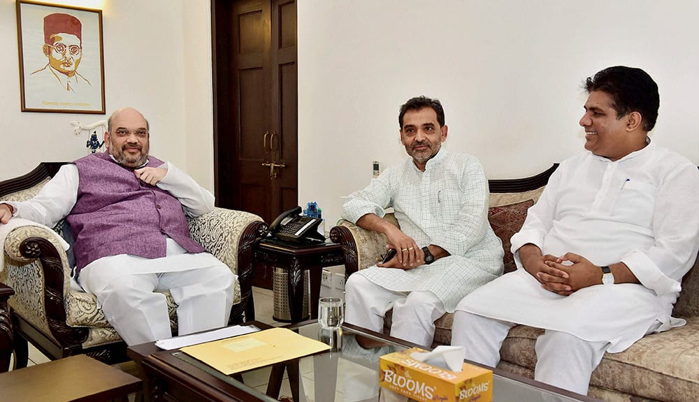 BJP President Amit Shah during a meeting with Rashtriya Lok Samata Party leader Upendra Kushwaha and BJP leader Bhupender Yadav.