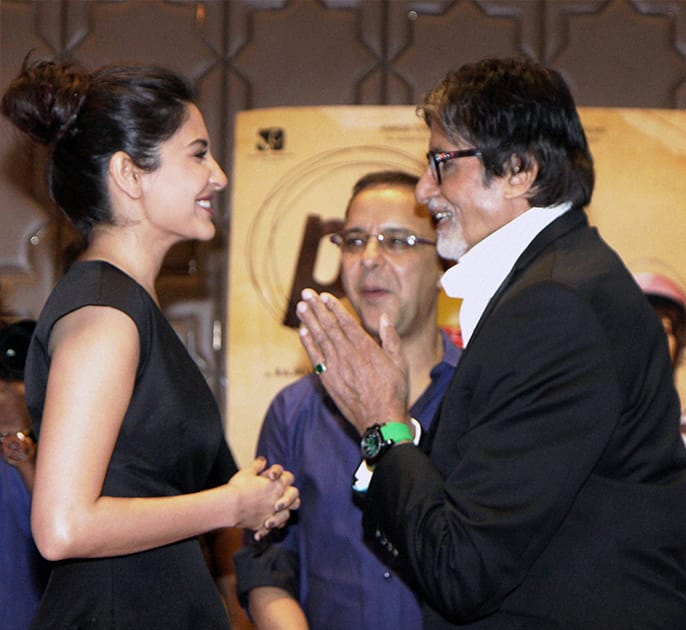 Bollywood actors Amitabh Bachchan and Anushka Sharma with filmmaker Vidhu Vinod Chopra during the success party of film PK in Mumbai.