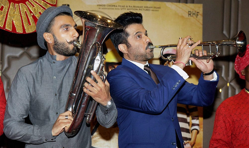 Bollywood actors Anil Kapoor and Ranveer Singh during the success party of film PK in Mumbai.