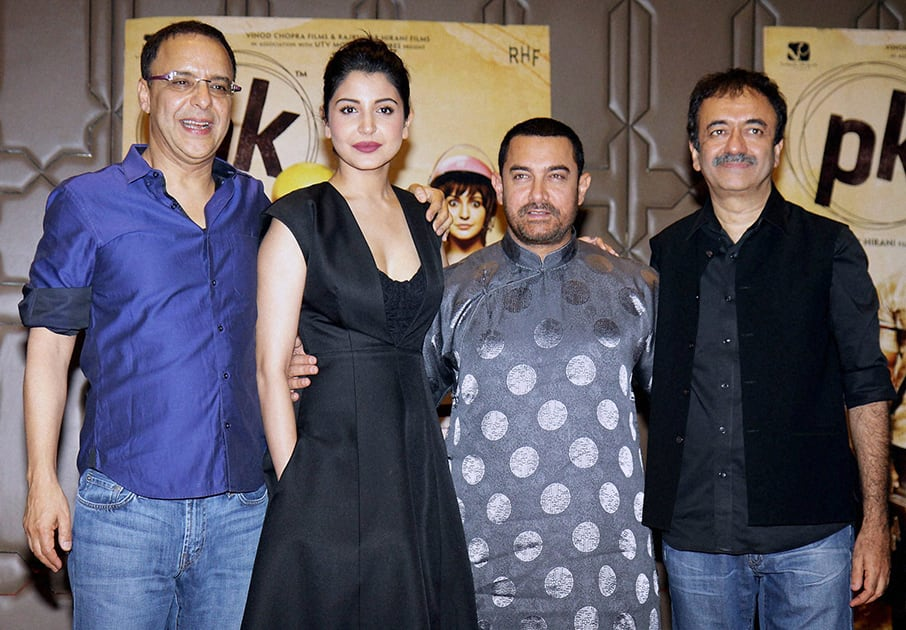 Bollywood actors Aamir Khan and Anushka Sharma with filmmakers Rajkumar Hirani and Vidhu Vinod Chopra during the success party of film PK in Mumbai.
