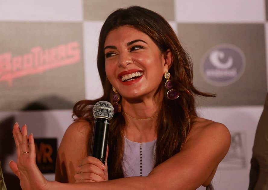 Bollywood actress, Jacqueline Fernandez gestures as she interacts with media during the trailer launch of her upcoming film 'Brothers' in Mumbai.