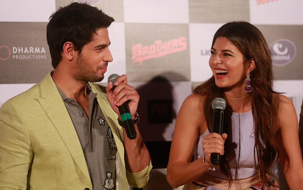 Bollywood actress, Jacqueline Fernandez right, shares a lighter moment with co star Sidharth Malhotra during the trailer launch of their upcoming film 'Brothers' in Mumbai.