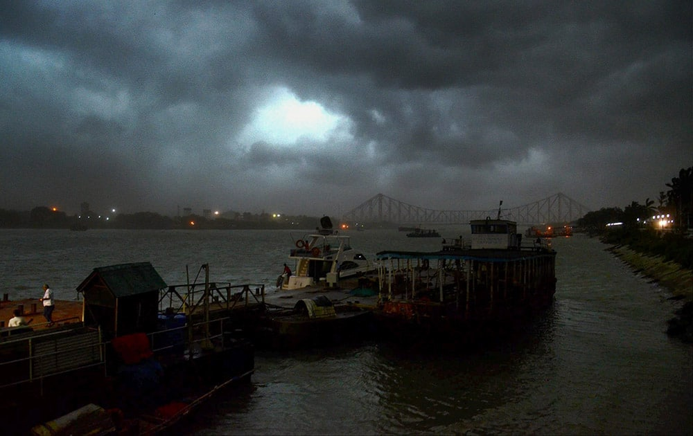Dark clouds & heavy wind covers the sky of Kolkata near Howarh Bridge on the first day of Monsoon in Kolkata.