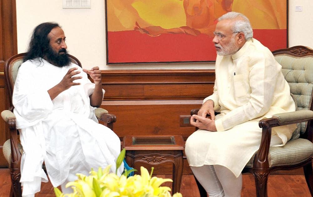 Prime Minister Narendra Modi with Sri Sri Ravi Shankar at a meeting in New Delhi.