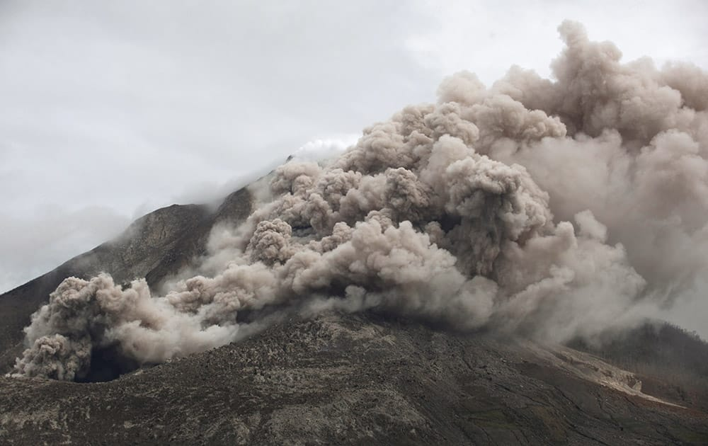 Mount Sinabung releases pyroclastic flows as seen from Tiga Serangkai, North Sumatra, Indonesia. The volcano has sporadically erupted since 2010 after being dormant for 400 years.