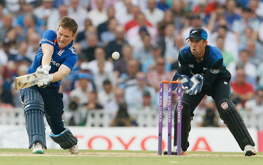 England's Eoin Morgan plays a shot off the bowling of New Zealand's Nathan McCullum during the one day international match at the Oval cricket ground in London.