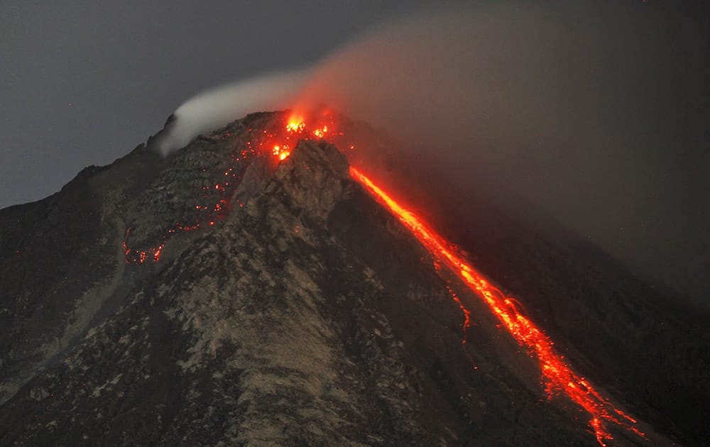 Hot lava flows from the crater of Mount Sinabung as seen from Tiga Serangkai, North Sumatra, Indonesia.