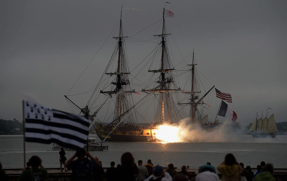 Cannon fire seen from the Hermione as it arrives at Riverwalk Landing Marina.