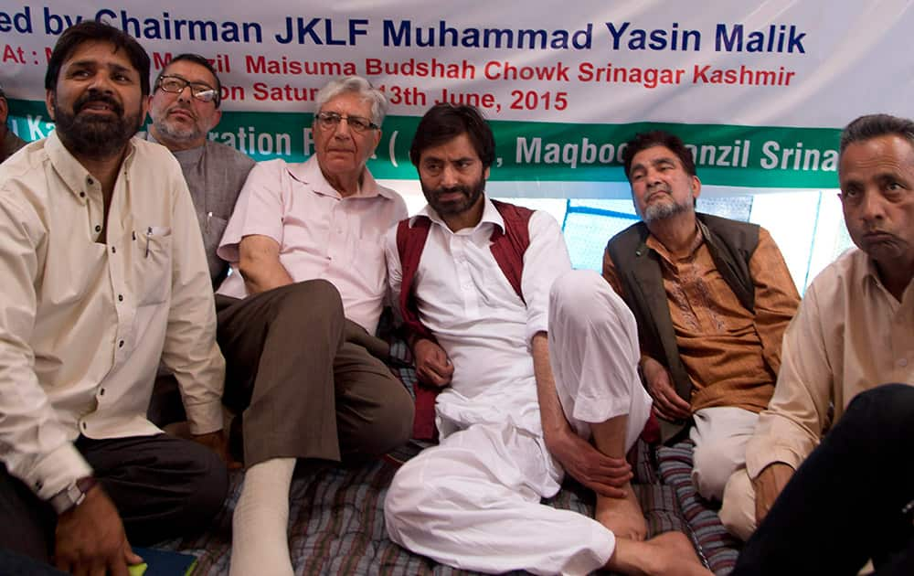 Yasin Malik, sits with other party workers on a daylong hunger strike in Srinagar.