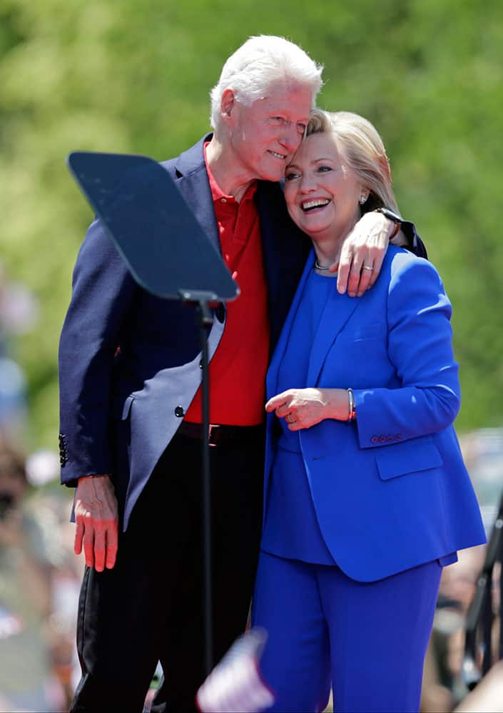 Democratic presidential candidate, former Secretary of State Hillary Rodham Clinton, left, hugs former President Bill Clinton after speaking to supporters, on Roosevelt Island in New York.
