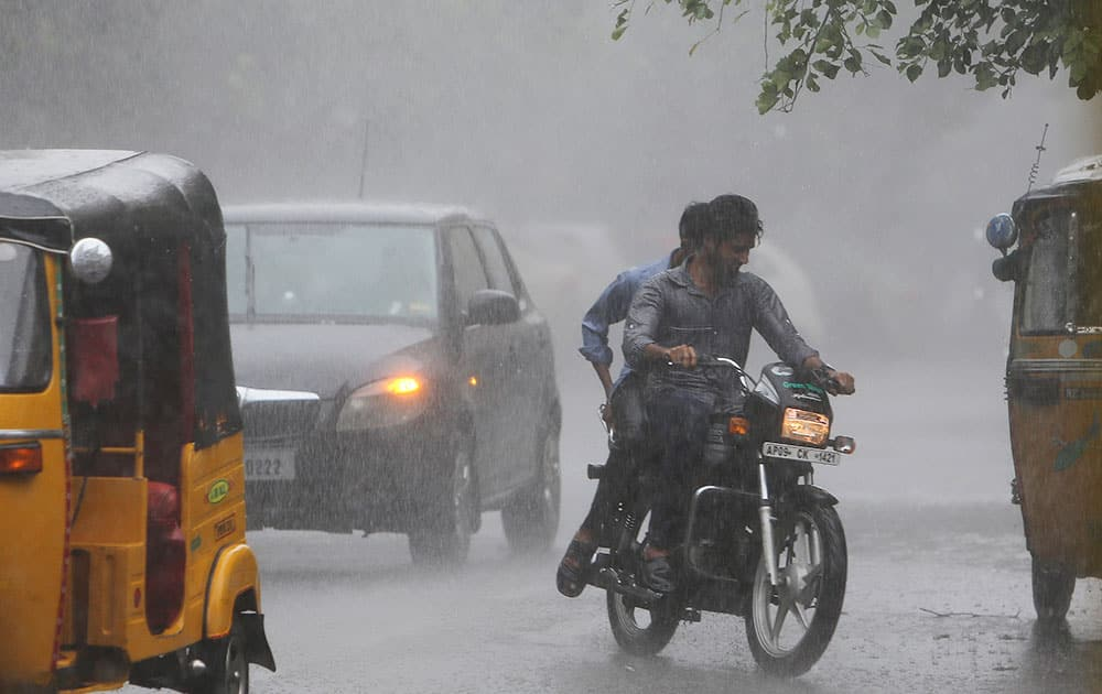 A motorist rides during a rain in Hyderabad, India.