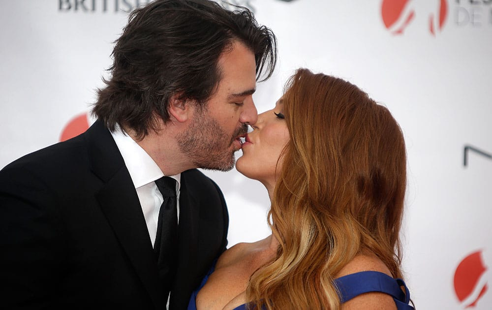 Australian and US actress Poppy Montgomery and her husband Shawn Sanford pose during the opening ceremony of the 2015 Monte Carlo Television Festival.
