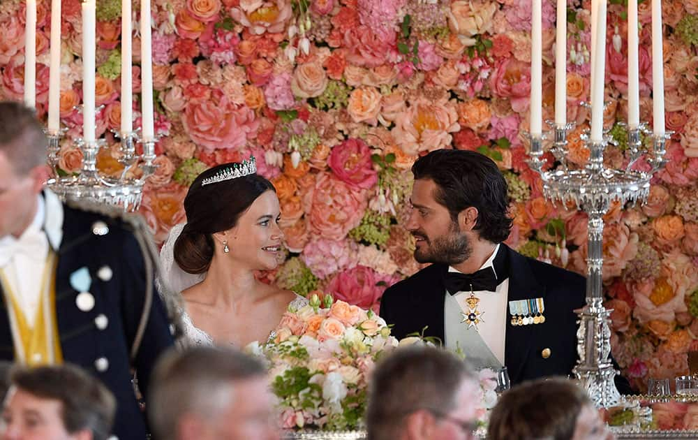 Sweden's Prince Carl Philip, right, looks at Princess Sofia, during the wedding dinner at the Royal Palace, in Stockholm, after their wedding ceremony.