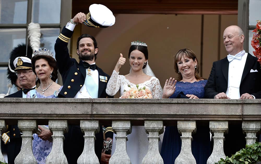 King Carl Gustaf, Queen Silvia, Prince Carl Philip, Sofia Hellqvist, Marie and Erik Hellqvist, are greeted by the people after their wedding in the Royal Chapel in Stockholm, Sweden.