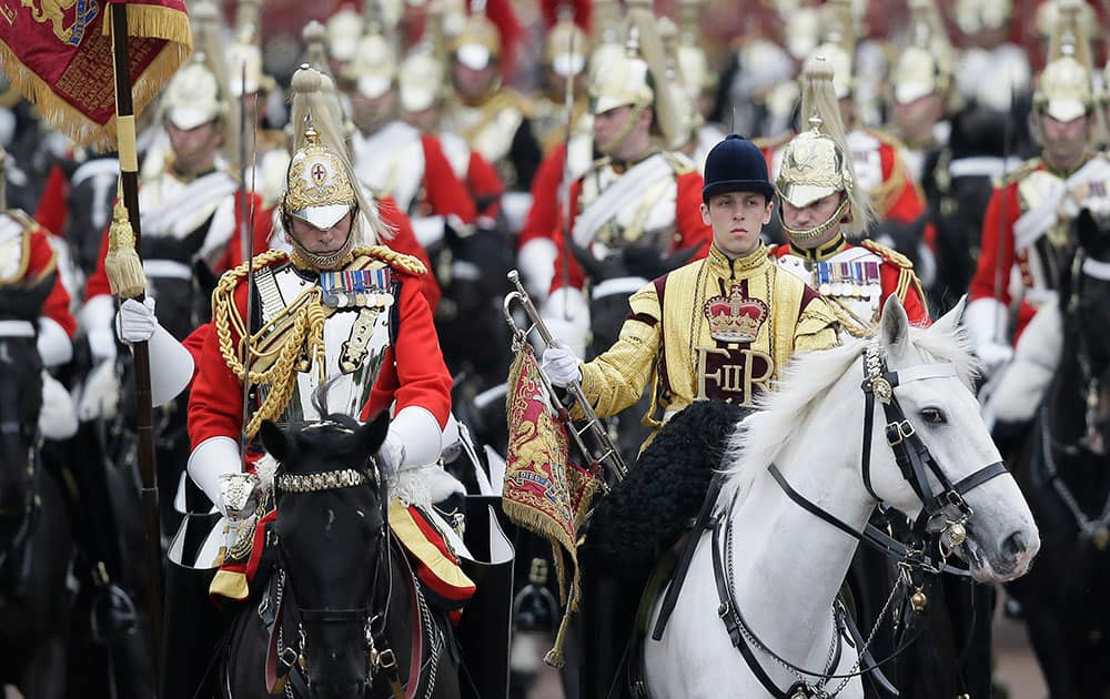 The Household Cavalry ride down the Mall during the Trooping The Colour parade at Buckingham Palace, in London.