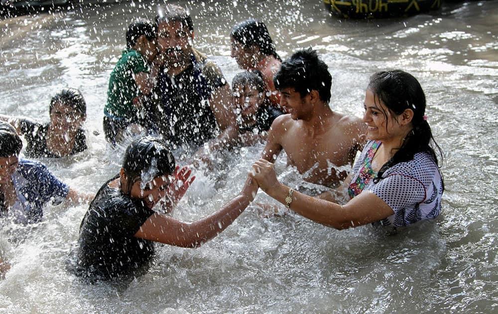 People enjoy a dip in Ranbir Canal to beat the heat in Jammu.