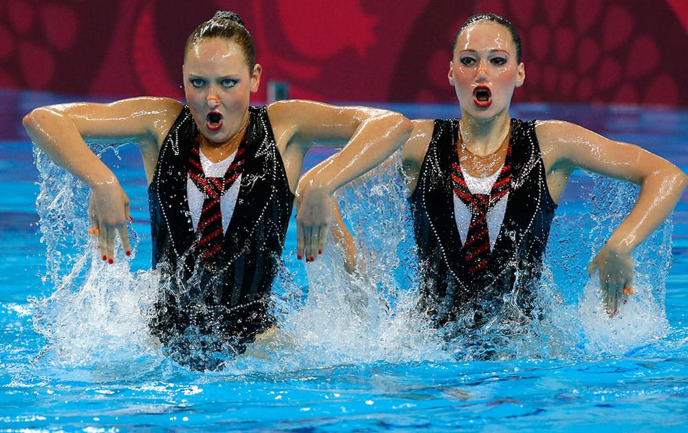 Valeriya Filenkova and Daria Kulagina of Russia perform during the final of synchronised swimming duets event at the 2015 European Games in Baku, Azerbaijan.